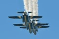 "four Kawasaki T4 aircraft of the Japanese Air Force display team ""Blue Impulse"" showing of their close formation flying skills during the 2012 Tsuiki airshow."