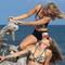 Nathalie Zach and Nicole van der Velden modeling for Olga Papkovitch couture swimwear in Aruba by Tony Filson of KissMyKite Fashion