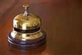 vintage brass bell in hotel lobby