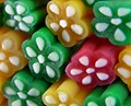 These liquorice pieces have a firm texture and different flavours. The green is apple, yellow is pineapple and red is strawberry. The white parts are a very firm 'fondant' substance with a sweet neutral taste. if you squeeze them quite hard it starts to ooze out. Great fun! :-).