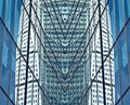 A photo of Turning Torso in Malmö, Sweden, reflected in a nearby office building. I cropped the image at the edge of the building, copied it, reflected the copy, enlarged the canvas, pasted the copy onto the original then flattened the image.