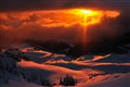 Winter sunset from a mountain slope