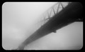Sydney Harbour Bridge consumed by morning fog.