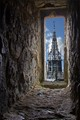 This window was made around 1136. It sits high up in a twelve sided 'motte-and-bailey' style castle keep. The ornate Gothic spire (another part of the castle) that the window now looks onto was made in 1860. The spire sits on an octagonal stone tower that was built in 1423.  Over the centuries this castle has seen many bloody battles and has consequently been owned by many kings, dukes and lords etc.