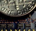 screensaver macro of circuit board with dime