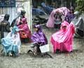 Children in very heavy rain!