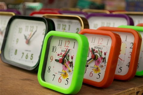 Colorful clocks on a table
