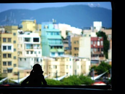 When - Young Lady Enjoying View of Hong Kong