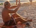 Gadget-Laden Tourist At The Beach