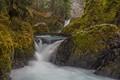 Slack rope walker over a waterfalls