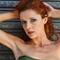 red head with bare arms