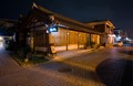 Brown, wooden house and brown cobblestone street of historical Hanok Village in Jeonju City, South Korea