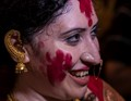in red vermilion,as an  farewell to The Goddess Durga ,after Her Grand worship over a couple of days,Kolkata,India.