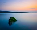 Lonely rock at sunset