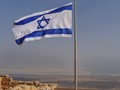 Israeli flag on Matsada Citadel (Dead sea in backward)