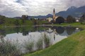 "Baroque church ""Zum Heiligen Ägidius"" (Saint Giles) reflected in the lake at Reith, Austria. A beautiful calm village in the Tyrol very close to  Kitzbühel."
