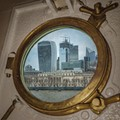 upon my quick visit late evening, I Had taken is photo from inside the HMS Belfast. The picture consists of the port hole and the city scape on the other side of the bank of the thames.