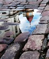 Tallinn cobblestone reflection