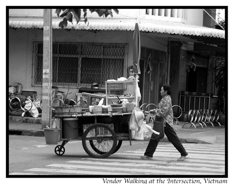 Vendor walking at the Intersection, Vietnam