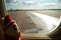 Plush Dwarf Nils Leaving Stockholm (on a jet plane!)