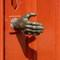 Door with bronze hand Maastricht The Netherlands