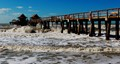 Naples Pier during high surf...