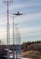 A jet landing over Kincaid Park at Ted Stevens International Airport in Anchorage, Alaska.