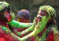 My nieces splattering colors on each other during the festival of Holi.