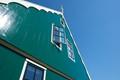 Green wooden house in de Zaanstreek
