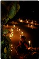 Candels of hope on the river of sorrow.