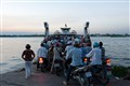 Queue for the ferry across Mekong river to Bén Tre