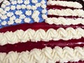 Photo of 4th of July Cake that I bought at a bakery.  Took the photo then had a bite.  Cake was not too bad thought a little on the sweet side.