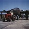 B25 bomber planes at the North American Aviation, Inc., being hauled along an outdoor assembly line with an International tractor, in Kansas City, Kansas, in October, 1942