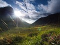 Sun shines through Glen Coe