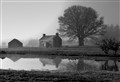 Farm house in the mist