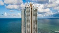 The 47-Story Akoya Building in Miami Beach. There are 2 glass elevators that go up and down the center