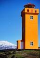 Orange tower, glacier and moon