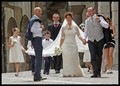 Wedding party walking thru square to church