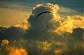 Sunset parachuting.