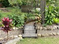 Tropical garden and dry creek bed