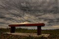 Bench under a Fierce Sky