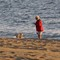 a lady and her dog on the beach in southern france