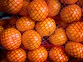 ORANGES IN RED NETTING