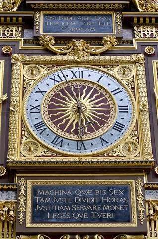 Very old clock at Ile de la Cite - Paris