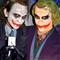 Joker Cosplayer Joking on a Joker Bust while holding a Joker Card