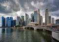 Singapore's waterfront and financial district, hazy with the gathering storm clouds.