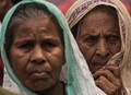 Strong-weak-two old female pilgrims on their