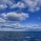 Clouds and Blue Sky above the Sea