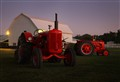 Old tractors at dusk