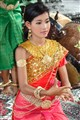 Cute girl in traditional dance at AngkorWat